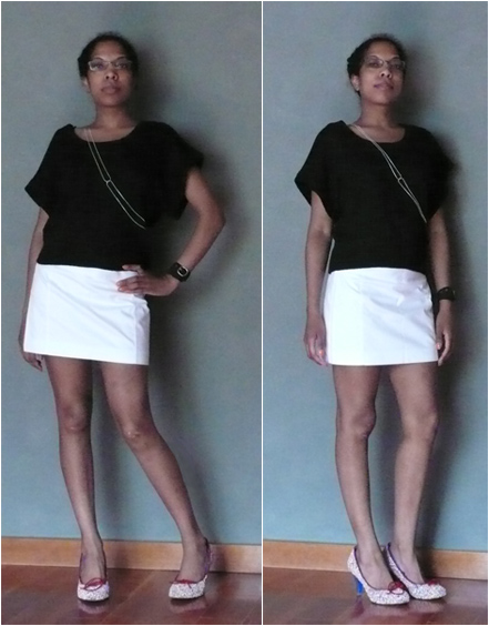 White skirt, black boxy sweater, candy shoes, silver harness necklace, red purse